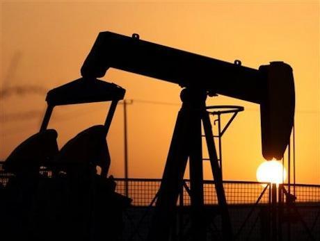 Oil up 4 percent as OPEC meets