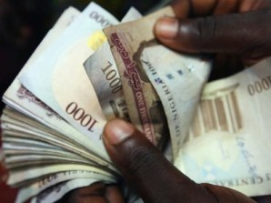 Naira firms N1.47k against dollar as CBN sales $300m