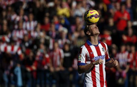 Spain forward Torres controls the ball during his presentation ceremony at Vicente Calderon stadium in Madrid