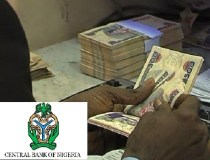 Bond yields fall, naira eases on black market on rate cut