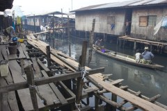 Living in slums amidst unoccupied mansions