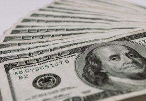 100-dollar-bills-1-560x390