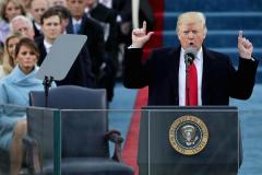 Trump sets tone for presidency with attack on 'dishonest' media