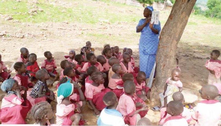 Nigerian children learning under trees in the 21stCentury!