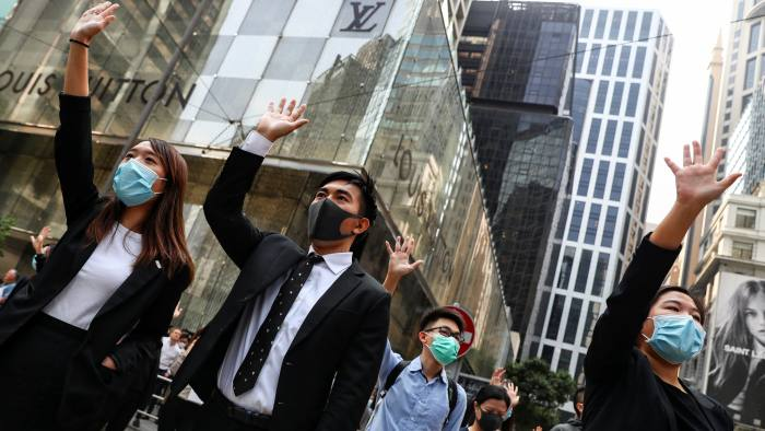 Employers act to protect staff as Hong Kong crisis deepens