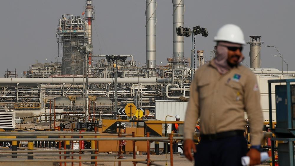 Oil drops more than  after Saudi price cuts, demand optimism fades