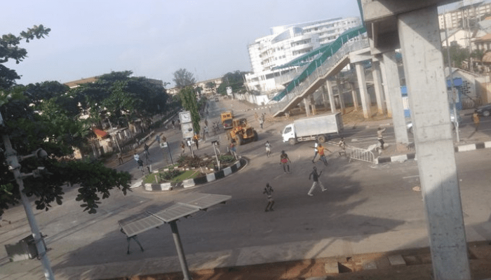 Alausa erupts in violence as hired hoodlums attack protesters